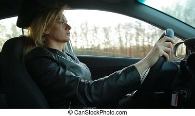 Blondie young woman driving a car