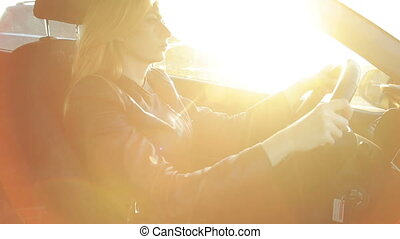 young woman leads a car on the highway, autumn
