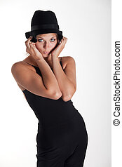 blone woman with a black hat