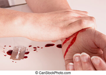 Blood and suicide - Suicide attempt of a bloody wrist and...