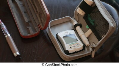 Blood Glucose Testing Kit - Overhead panning shot of a blood...