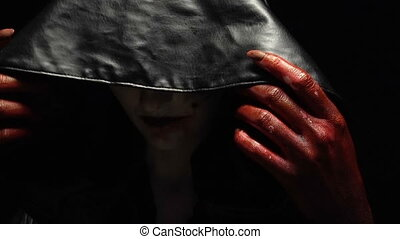 Blood hands of girl in image - Footage of woman in black...