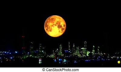 blood harvest moon moving pass light oil refinery and dark...