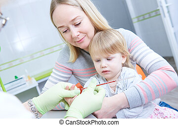 Blood medical test or research. Taking a blood sample from child finger in hospital