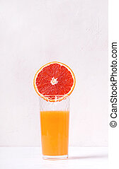 Blood orange juice freshly squeezed in the drinking glass