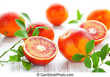Blood oranges - Several blood oranges with leaves,whole and...