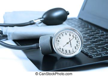 Blood pressure instrument on a computer keyboard