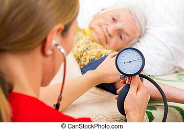 Blood pressure measurement - Young doctor measures the...