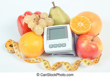 Blood pressure monitor, fresh ripe fruits with vegetables and centimeter, healthy lifestyle