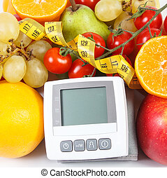 Blood pressure monitor, fruits with vegetables and centimeter, healthy lifestyle