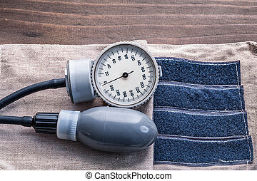 blood pressure monitor on wooden boards close up