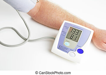 Blood pressure monitoring - Man measuring his own blood...