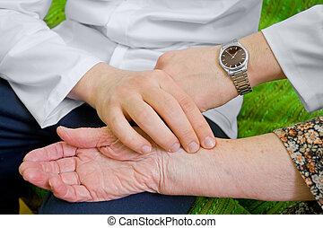 Blood-pressure - The doctor measures old lady's...