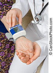 Blood pressure - The doctor measure the old woman's blood...