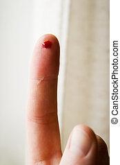 Blood Prick - A bleeding finger.