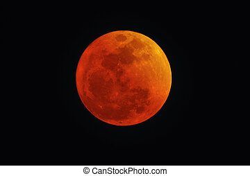 Blood Red Moon during Lunar eclipse. Concept photo of...