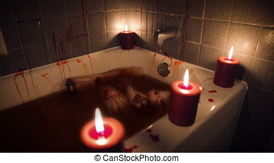 Bloody bathtub with body parts by candlelight - High Angle...