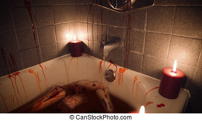 Bloody bathtub with body parts  by candlelight - Tilt Down