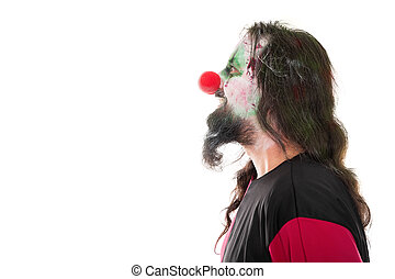 bloody clown in a face profile looking at a copyspace, isolated on white