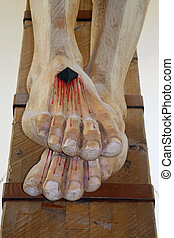 bloody feet of Jesus Christ nailed to the cross