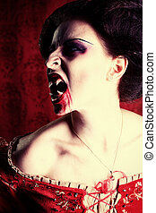 bloody grin - Portrait of a bloodthirsty female vampire over...