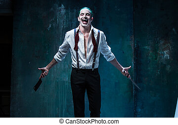 Bloody Halloween theme: crazy joker face - Bloody Halloween...