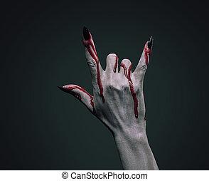 Bloody hand vampire - Vampire hand in blood on dark...