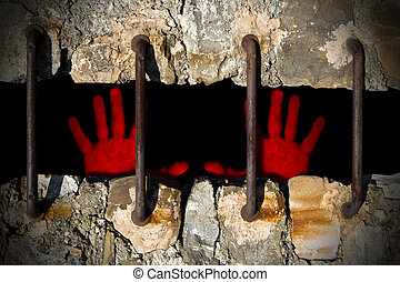 Two bloody red hands on a prison, concept of violence and injustice
