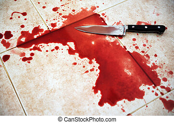 Conceptual image of a sharp knife with blood on it resting on tiles on the floor