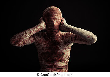 Bloody mummy with hands on hears - Front view on single...