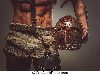 Bloody muscular torso and helmet of gladiator. - Wounded...