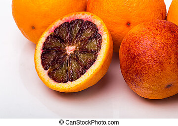 Bloody red oranges isolated on white background