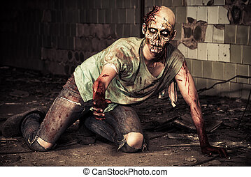 bloody - Horrible scary zombie man on the ruins of an old...