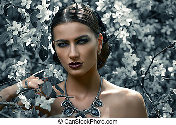 blooming garden - Close-up portrait of a beautiful brunette...