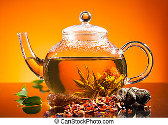 Blooming tea - Teapot with blooming tea on glass