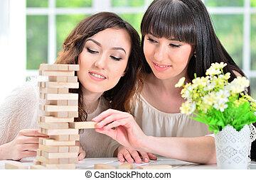 bloques, juego, mujeres