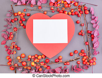Blossoming apple tree branches with decorative red heart on gray background. Copy space. Valentine's day, the holiday of love