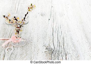 blossoming apricot branches in a vase of glass.