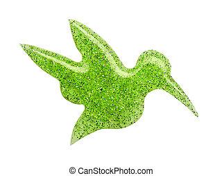 Blot of light green nail polish shaped hummingbird isolated on white