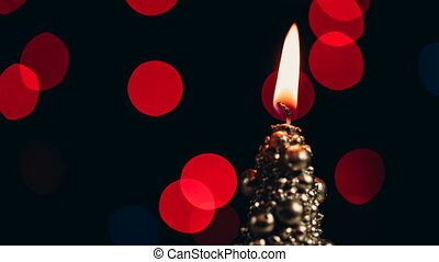 Blow and extinguish a flame of a christmas candle. Close up...