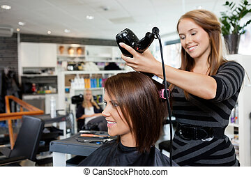 Blow Drying Hair After Haircut - Beautician blow drying...