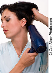 Blow drying hair - Attractive short hair brunette woman up...