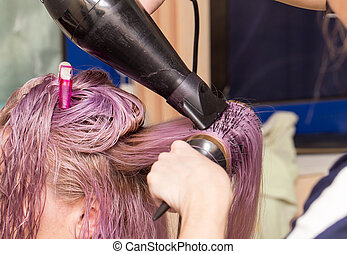 blow-drying hair in a beauty salon