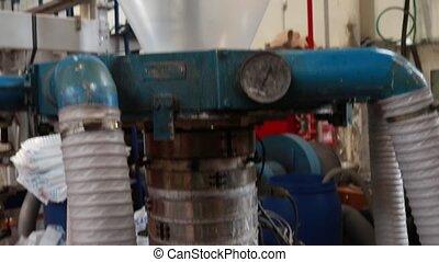 Blow extrusion of plastic film - Heating polyethylene...