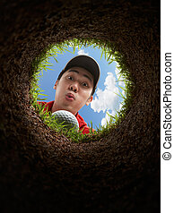 blow it! - golfer blowing golf ball, view from inside the...