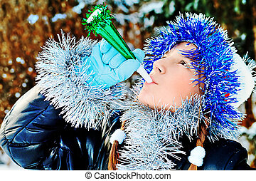 blow - Teenager girl having fun outdoor on winter.