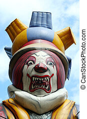 Blow up scary clown against blue sky