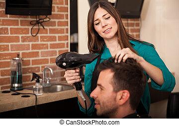 Blowdrying hair at a salon