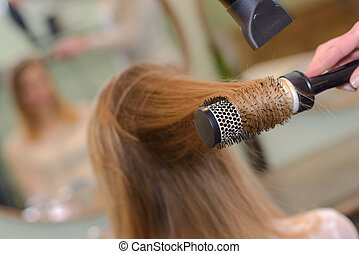 blowdrying the hair