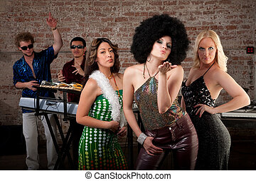 Blowing a kiss at 1970s Disco Music Party - Cute girl with...
